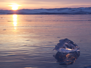 A piece of ice lying on the frozen surface of lake Baikal