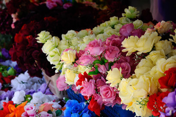 Artificial flowers made of cloth and plastic are sold to the public. It is made in various types and colors could give the option to the buyer.