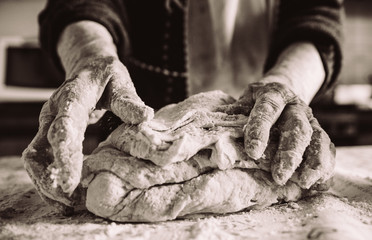old  italian lady's hands making home made italian pasta