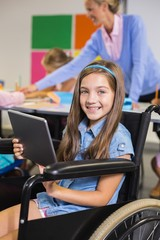 Disabled schoolgirl using digital tablet