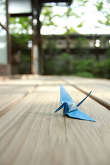 Paper crane resting on wooden veranda of Japanese traditional house