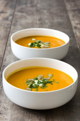 Pumpkin soup in bowl and pumpkin seeds