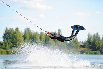 Man does wakeboarding sport. Wall mural