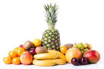 Fresh fruits.  Assortment of exotic fruits isolated on white