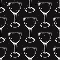 Vector grunge seamless pattern with wine glasses on black background. Hand drawn style.