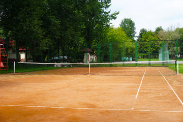 The game on the tennis court in the evening