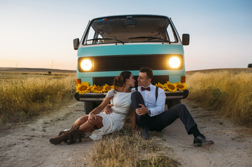A newlywed couple is in love with a retro minivan