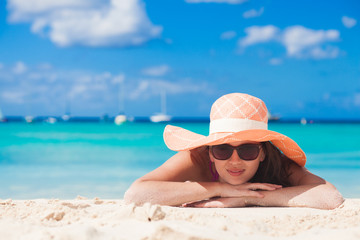 portrait of woman in bikini relaxing on tropical beach