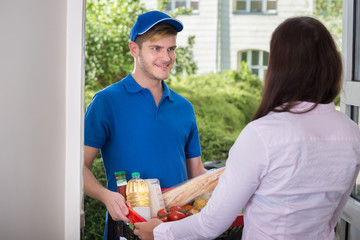 Smiling Young Woman Delivers Groceries