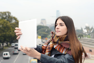 Young woman taking selfie with her tablet.