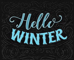 Hello winter text. Vintage chalk lettering on blackboard with swirls and decorations. Vector typography card.
