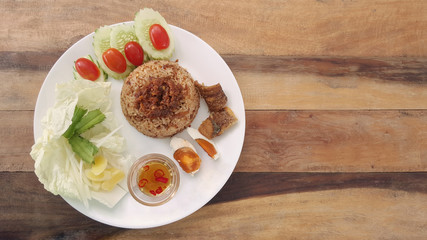 rice with fried mackerel boil egg shrimp paste chili sauce and vetgetable and fish fry  original thai food