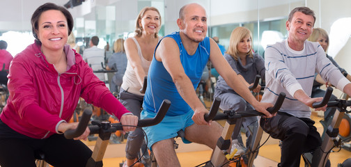 older men and women are engaged in the gym