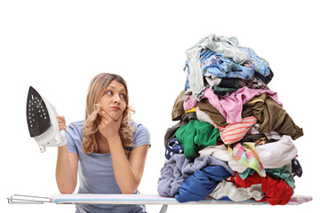 Woman looking at a pile of clothes