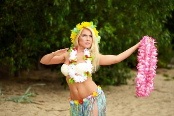 Beautyful hula hawaii dancer girl dancing on beach