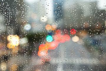 Defocused city view through rainy window