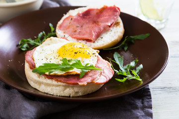 Sandwich with meat and fried egg