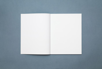 Blank open magazine isolated on grey background