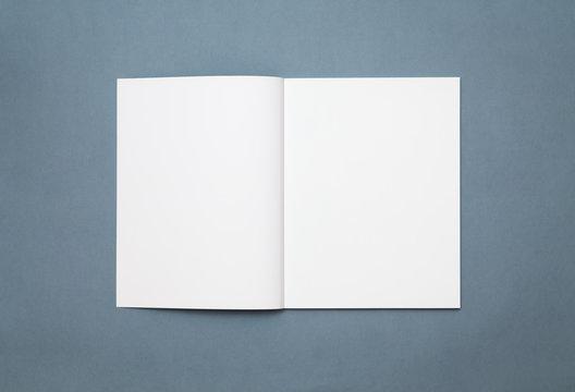 Blank open magazine isolated on grey background