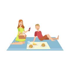 Couple Having Burgers On Picnic