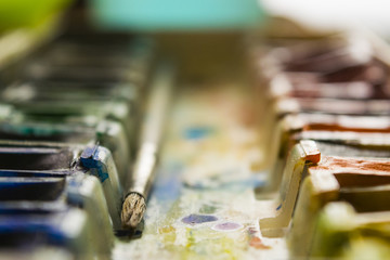 Set of watercolor paints and paintbrushes for painting closeup
