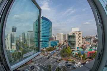 Wide angle shot of city panorama with intense car traffic on the streets. View from the window to Seoul, South Korea