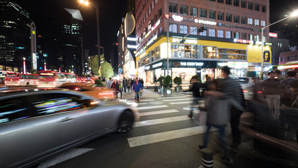 SEOUL, SOUTH KOREA - OCTOBER 22, 2015: Pedestrians crossing the road on zebra in big night illuminated city