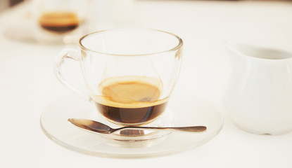 cup of black organic coffee as a symbol of courage and pleasure