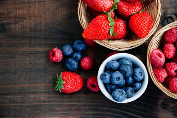 Beautiful berries on wooden background