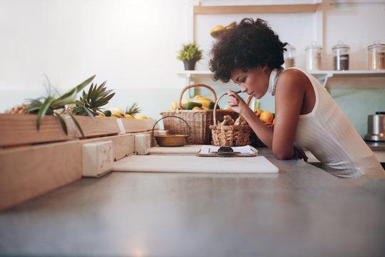 Proprietor of a juice bar calculating a her business expenses