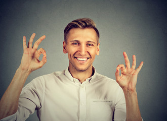 happy man showing OK gesture with hands