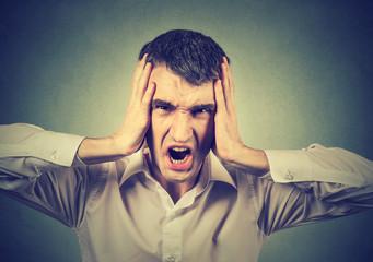 Screaming stressed man
