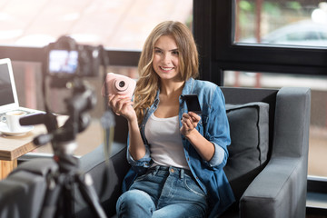 Positive woman shooting a video