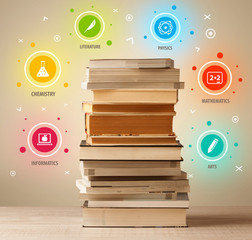Books on top with colorful symbols on vintage background