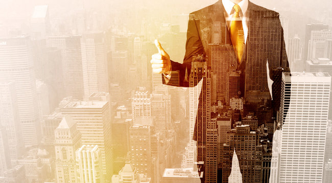 Business man looking at overlay city background