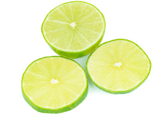 sliced green lemons, lemon is a sour juicy fruit