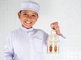 muslim children in traditional dress holding white lantern