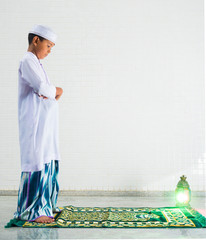 Muslim child worships and prays for Allah