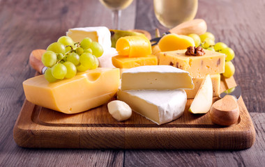 Many sorts of cheese with fruits