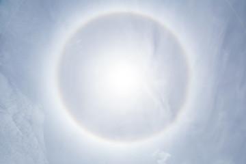 sun halo phenomenon, sun halo effect, sun ring in clear blue sky