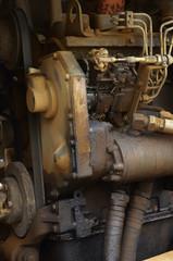 Old engine of grader car with oil engine leak