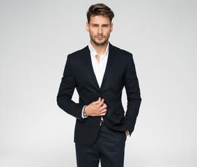 Portrait of handsome man in black suit - fototapety na wymiar