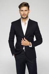 Portrait of handsome man in black suit