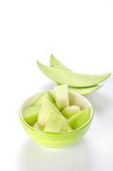 green melon in bowl