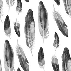 Modèle sans couture avec des plumes aquarelles noires. Texture ethnique.