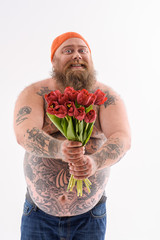 Funny thick guy giving bouquet with joy