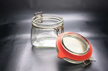 Empty glass jar with the open cap hold