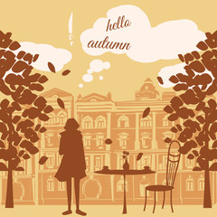 Urban autumn landscape with a street cafe on the background of the old town and the inscription is the coffee time