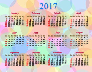 calendar for neat 2017 year with multicolored rings and circles