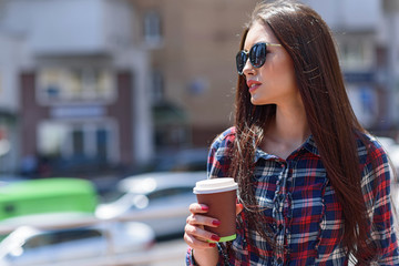Pensive girl enjoying hot drink outdoors
